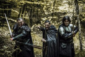 Three Medieval Holding Swords